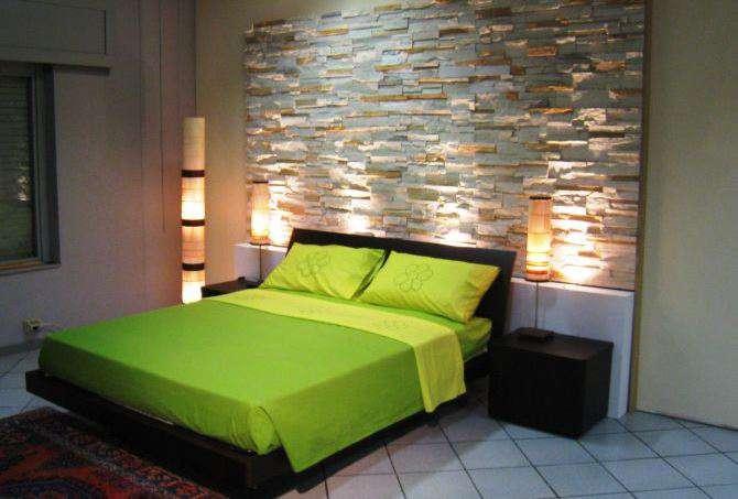 Parete in pietra finta o vera in soggiorno camera da letto - Disegni parete camera da letto ...