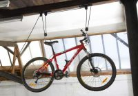 Dove mettere la bicicletta da corsa, mountain bike in casa senza garage [Supporto da muro]
